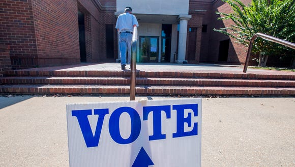 Voters arrive to vote at the polls located at Montgomery