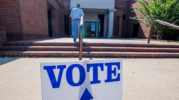 Voters arrive to vote at the polls located at Montgomery Museum of Fine Arts in Montgomery, Ala., on Tuesday September 26, 2017. Tuesday is the Republican runoff in the U.S. Senate race.
