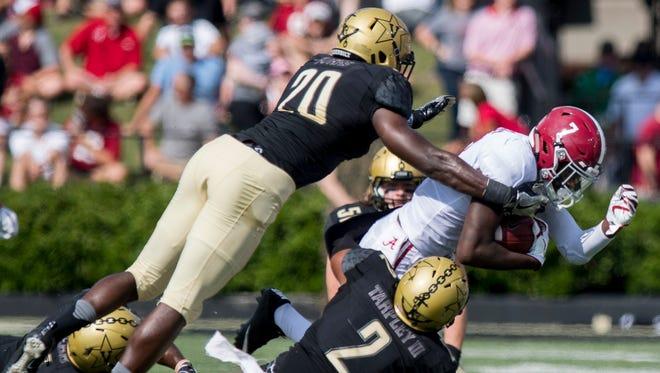 Alabama defensive back Trevon Diggs (7) is stopped by Vanderbilt linebacker Oren Burks (20) and defensive back Arnold Tarpley III (2) at Vanderbilt Stadium in Nashville, Tenn. on Saturday September 23, 2017. (Mickey Welsh / Montgomery Advertiser)