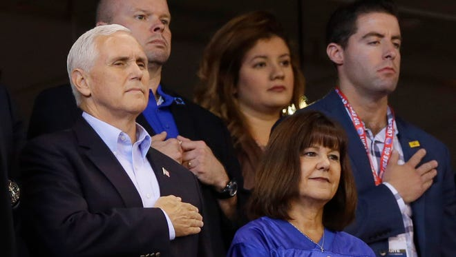 Vice President Mike Pence and his wife, Karen, stand during the playing of the national anthem before an NFL football game between the Indianapolis Colts and the San Francisco 49ers, Sunday, Oct. 8, 2017, in Indianapolis. (AP Photo/Michael Conroy)