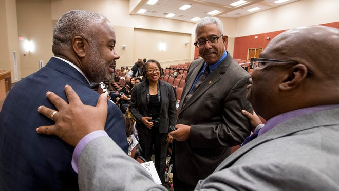 Alabama State University President Quinton Ross, left,  greets Gray Franklin, center, descendent of two of the Marion Nine, and university archivist Howard Robinson during a presentation on the ASU campus in Montgomery, Ala. on Tuesday November 21, 2017.