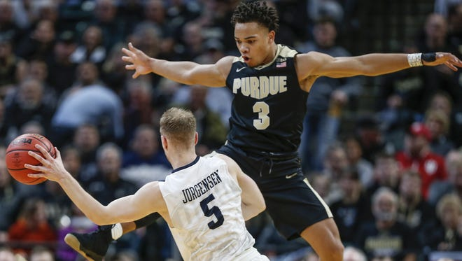 Purdue Boilermakers guard Carsen Edwards (3) goes up to block a pass by Butler Bulldogs guard Paul Jorgensen (5) during the Crossroads Classic at Bankers Life Fieldhouse in Indianapolis on Saturday, Dec. 16, 2017.