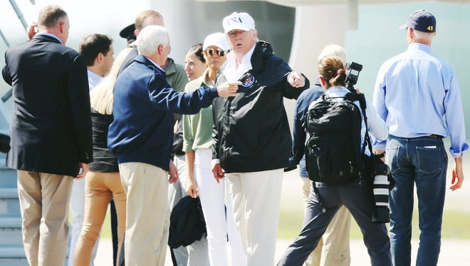 President Donald Trump and Vice-President Mike Pence arrive in September at Southwest International Airport in Fort Myers. The President will be visiting areas that were ravaged by Hurricane Irma. Governor Rick Scott, right, greeted the President.
