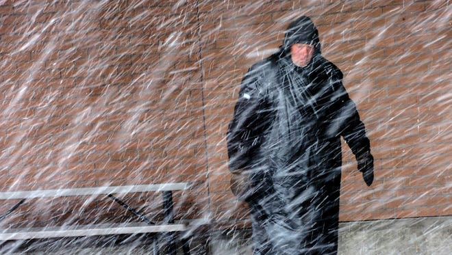 As a spring snow storm blankets Great Falls, Larry Kiedrowski kept out of the weather the best he could under the entry at a grocery store in 2007.  Kiedrowski lived on the streets of Great Falls for more than a dozen years.