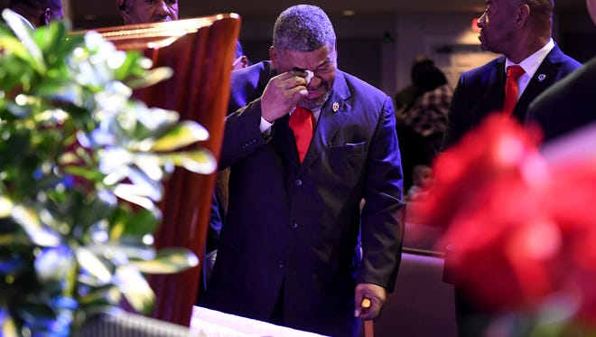 James Wolfe wipes away tears as he views the body of his wife, Denise LaSalle during her celebration of life, Monday, Jan. 15, at Englewood Baptist Church.