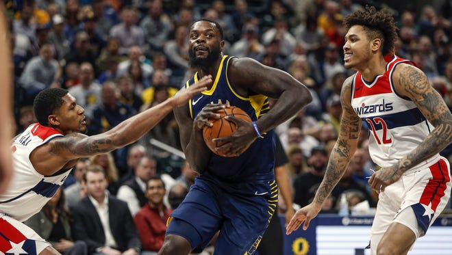 Indiana Pacers guard Lance Stephenson (1) drives past Washington Wizards guard Bradley Beal (3) at Bankers Life Fieldhouse on Monday, Feb. 5, 2018.