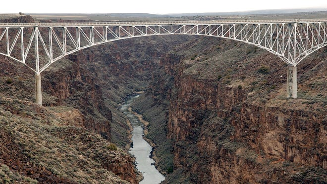 In this March 29, 2005 file photo, the Taos Gorge Bridge is seen near Taos N.M. New Mexico lawmakers are pushing a measure aimed at curbing suicides at the Rio Grande Gorge Bridge.