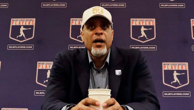 Tony Clark, executive director of the Major League Players Association, answers questions at a news conference in Phoenix on Feb. 6.