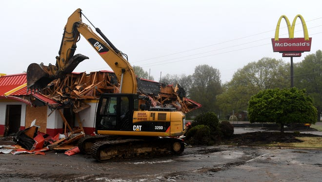 An excavator demolishes the 35-year-old McDonald's in Humboldt, Tuesday, April 24. A new McDonald's is expected to be built and opened by late summer.
