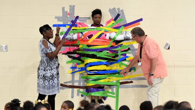 Students at Andrew Jackson Elementary School were given the opportunity to duct tape their principal, Ramonica Dorsey, to the wall, Friday, May 4. Students paid $1 for a strip of tape. Over $500 was raised to donate to Relay for Life.
