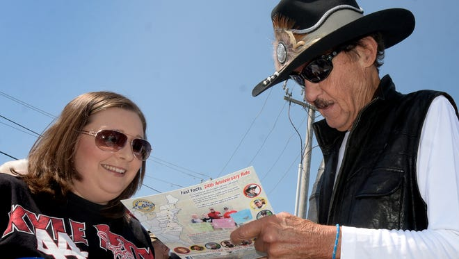 Former NASCAR driver Richard Petty signs a card for Danielle Wiseman of Spring Grove during an autograph session at 1st Capital Harley-Davidson in 2018. In 1961, Petty won a NASCAR National Short Track Series race Lincoln Speedway.
