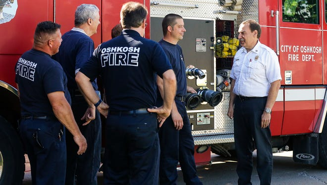 Oshkosh Fire Chief Tim Franz (far right) tells a story Friday, June 8, 2018, to firefighters Joe Geiger, Kevin Gerarden, John Holland and Matt VanZeeland. Franz retired Friday after 33 years with the department.