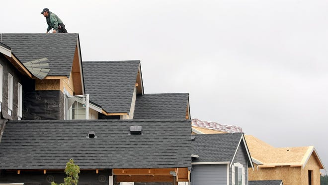 A new housing development rises in Silverdale. There were 1,200 new housing units constructed in Kitsap County between 2017 and 2018.