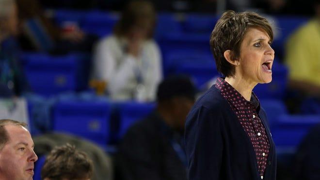Oakland girls basketball coach Jennifer Grandstaff coaches her team against Bartlett during Class AAA state quarterfinals Wednesday, March 4, 2015.