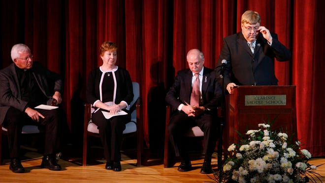 Bill Wielinski, right, speaks at a memorial service for his brother Douglas Wielinski  at the Clarence Middle School Auditorium in Clarence, Feb. 21, 2009.