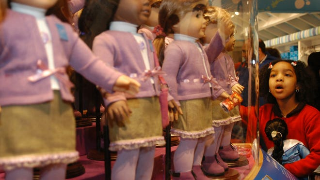 A girl looks at dolls for sale at the American Girl Place store in New York on Nov. 8, 2003.