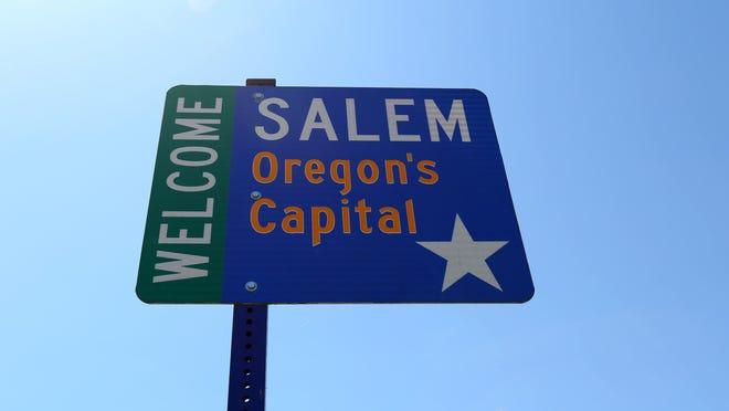 A sign along River Road shows where Keizer meets Salem.