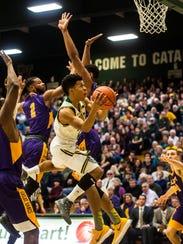 UVM's #2 Trae Bell-Haynes splits Albany's defense,