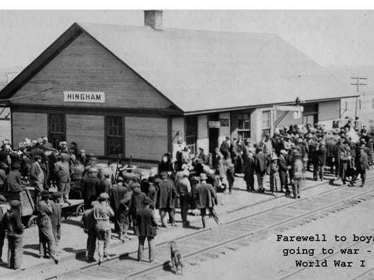 Hingham was only four years old when World War I erupted in Europe. In this early photo, the town gathers at the train depot to bid farewell to departing soldiers.