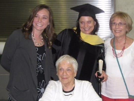Michelle Packard celebrated her graduation from Michigan State University in May 2012. From left, Michelle's sister, Elyse Packard, Michelle Packard, her mother Pamela Leidlein and her grandmother Marjorie Leidlein.