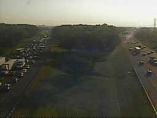 Southbound I-95 traffic (left) jams near Del. 141 about 7:50 a.m. Tuesday.