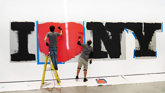 Painters install an oversized presentation of the iconic I Love NY logo designed by Milton Glaser inside the west end of The Museum of Modern Art lobby in preparation for the museum's reopening on August 27 as the city continues Phase 4 of re-opening following restrictions imposed to slow the spread of coronavirus on August 20, 2020 in New York, New York. The fourth phase allows outdoor arts and entertainment, sporting events without fans and media production.