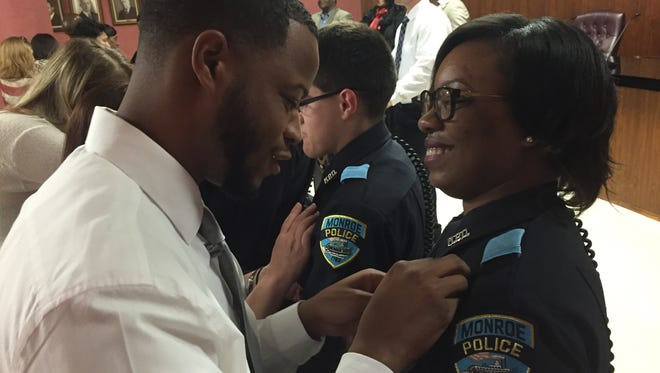 MPD Officer RaKeida Brothers has her badge penned to her uniform by her brother, Raschard Boatner.