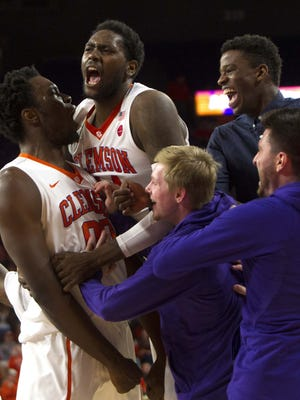Clemson Tigers center Legend Robertin (00) reacts with teammates during the first half against the Wake Forest Demon Deacons at Littlejohn Coliseum.