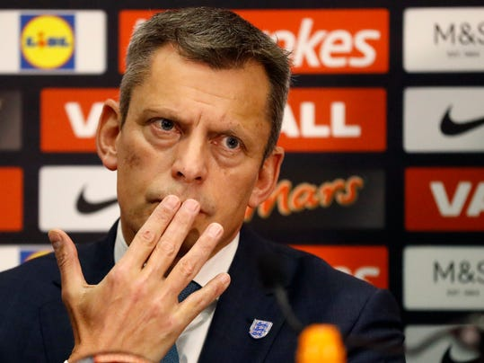 Martin Glenn, left, Chief Executive of the English Football Association listens to question during a press conference in the headquarters of the English FA, at Wembley stadium London, Thursday, Dec. 1, 2016. The press conference introduced the newly appointed England soccer team manger Gareth Southgate. (AP Photo/Frank Augstein)