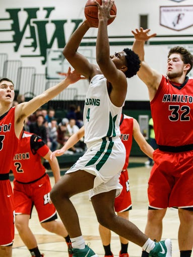 Wauwatosa West junior Aaron Greer (4) drives in for