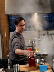 Chef Bradley Stellings races to prepare his Main Course dish in Round Two. The Round Two Basket ingredients are Whole Chicken Legs, Baby Zucchini, Spotted Dick (Steamed Pudding), and Riesling Ice Cream, as seen on Food Network's Chopped, Season 23.