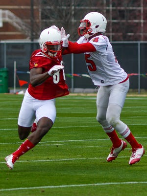Safety Josh Harvey-Clemons, right, defends tight end Charles Standberry while running drills during the University of Louisville's first spring football practice on the practice fields aside Papa John's Cardinal Stadium.Tuesday March 24, 2015.(Photo: William DeShazer, Special to The C-J)