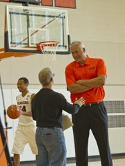 Statesman Journal reporter Gary Horowitz interviews men's basketball coach Wayne Tinkle at media day.