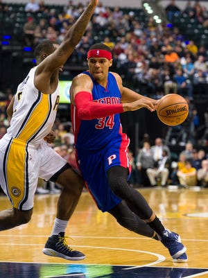 Pistons forward Tobias Harris drives the ball toward the basket as he's defended by Pacers forward Lavoy Allen during the first half in Indianapolis, Wednesday, March 8, 2017.