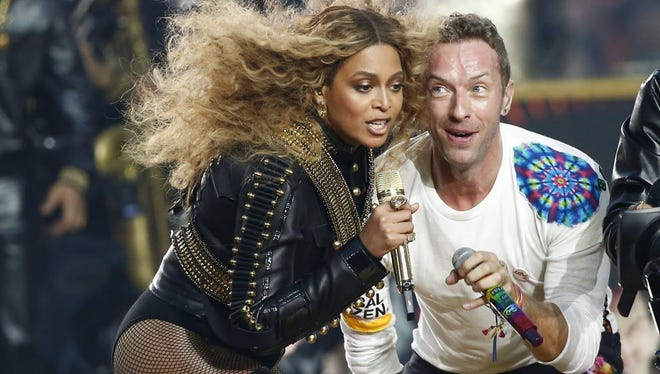 Beyonce performs with Coldplay's Chris Martin at Sunday's Super Bowl halftime show.