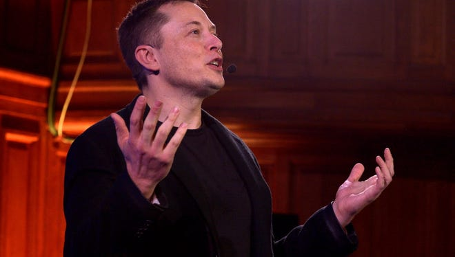 Elon Musk, CEO of US automotive and energy storage company Tesla, presents his outlook on climate change at the Paris-Sorbonne University in Paris on December 2, 2015.