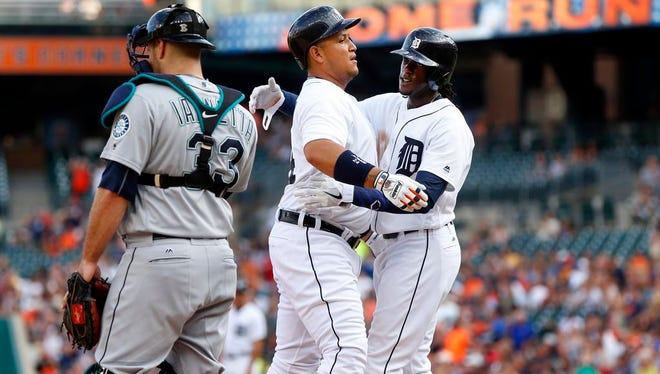 Cameron Maybin, right, had three hits for Detroit on Monday night.