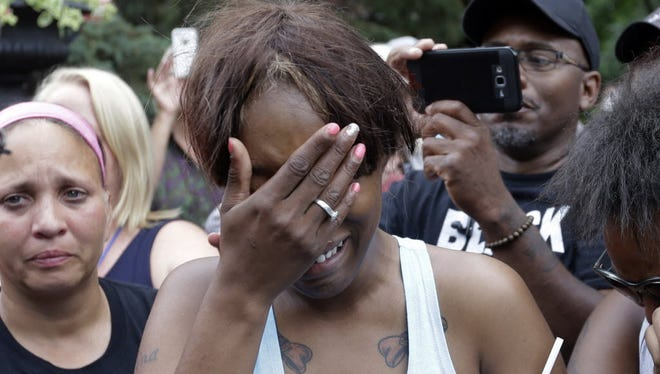Diamond Reynolds, the girlfriend of Philando Castile of St. Paul, cries outside the governor's residence in St. Paul, Minn., on Thursday, July 7, 2016. Castile was shot and killed after a traffic stop by police in Falcon Heights, Wednesday night. A video shot by Reynolds of the shooting went viral.