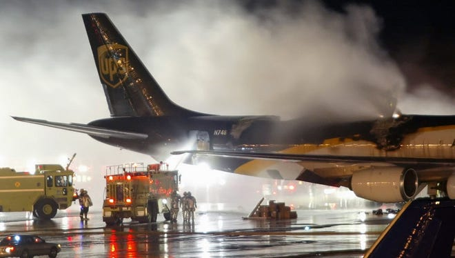 Firefighters battle a blaze onboard a UPS cargo plane at Philadelphia International Airport in Philadelphia on Feb. 8, 2006. The International Civil Aviation Organization, a U.N. agency that sets global aviation safety standards, decided to ban shipments of lithium ion batteries on international passenger flights and require that the batteries be no more than 30 percent charged on cargo flights.