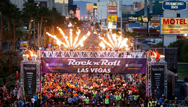 In this Nov. 16, 2014, file photo, runners begin the Rock 'n' Roll Las Vegas Marathon along the Las Vegas Strip in Las Vegas. More than 40,000 people will run on Sunday, Nov. 12, 2017, under the watchful eyes of snipers and surrounded by other law-enforcement safety measures during the Las Vegas Rock 'n' Roll Marathon, the first large-scale outdoor event the city's hosting since a gunman killed 58 people gathered at a country music festival last month.