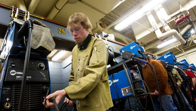Castleford student Keegan Myers works on his wielding project as part of his dual credit enrollment Thursday, Nov. 30, 2017, at the College of Southern Idaho in Twin Falls, Idaho.  Idaho, which boasts an unemployment rate below 3%, saw its population boom by 2.2% over the last year, according to newly-released U.S. Census data.