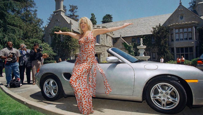 In this May 1, 1997, file photo, Victoria Silvstedt poses with her 1997 Porsche Boxter in front of the Playboy Mansion in Beverly Hills, Calif. The new owner of the Playboy Mansion has agreed to maintain the facade in its original condition under an agreement with the city of Los Angeles.