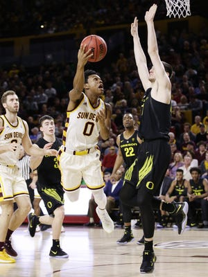 Arizona State guard Tra Holder puts up a shot against Oregon forward Roman Sorkin during PAC-12 action on Jan. 11, 2018 in Tempe, Ariz.