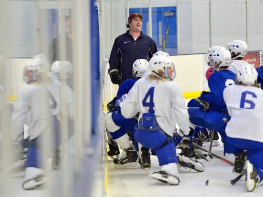 Sartell head boys hockey coach Ryan Hacker and his