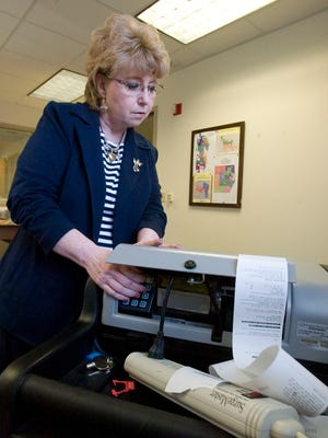 Retiring County Clerk Julie Glancey tests voting machines Thursday May 17, 2012, at the Sheboygan County Administration Building. Photo by Bruce Halmo/The Sheboygan Press
