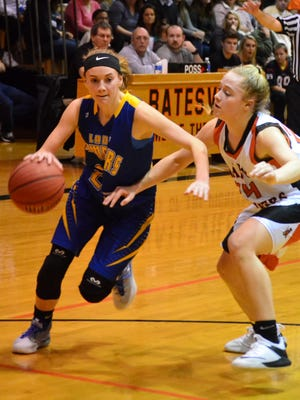 Mountain Home's Emma Martin drives to the basket against Batesville's Taylor Griffin on Friday night.
