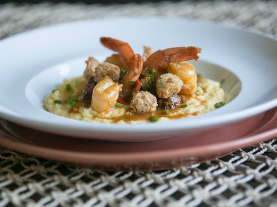 "Tanorria Askew's shrimp and grits, spiked with smoked paprika, full of spicy andouille sausage and topped with crispy deep-fried okra nuggets, earned her a ""white apron"" on Fox TV's ""MasterChef"" Season 7."