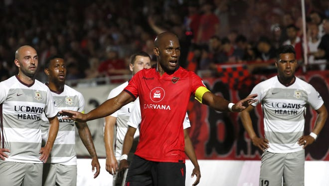 Phoenix Rising's Didier Drogba protests a goal being taken away after a mad scramble and collision near the net against Sacramento in the first half at the Phoenix Rising Soccer Complex in Tempe, Ariz. on May 19, 2018.