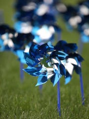A pinwheel is the logo of Prevent Child Abuse Indiana.