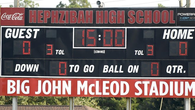 The Hephzibah High School scoreboard now with the new name of the stadium in honor of former Hephzibah High School player and coach John McLeod at Hephzibah High School in Hephzibah, Ga., Friday evening September 27, 2019. The Hephzibah High football stadium is now known as Big John Mcleod Stadium.   [MICHAEL HOLAHAN/THE AUGUSTA CHRONICLE]